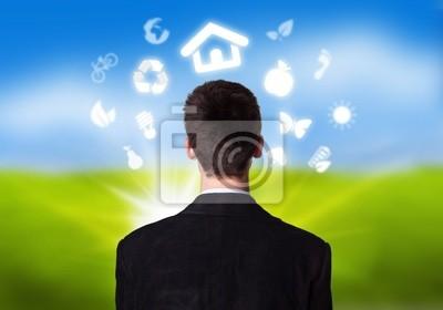 Geschäftsmann mit ECO-Symbole im Umlauf Kopf 2