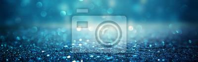 Bild glitter vintage lights background. black and blue. de-focused