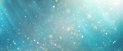 Bild glitter vintage lights background. silver, blue, gold and white. de-focused