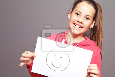 Glückliche junge Mädchen mit Smiley
