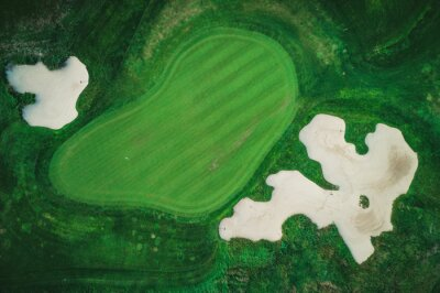 Golf course in luxury resort aerial drone view