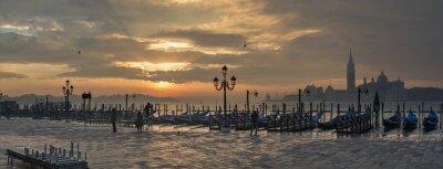 Bild Gondolas by Saint Mark square during sunrise with San Giorgio di Maggiore church in the background in Venice Italy