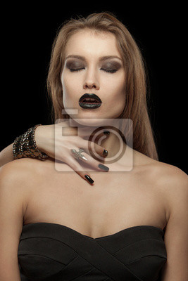 Gothic woman with hand of vampire on her neck. Halloween