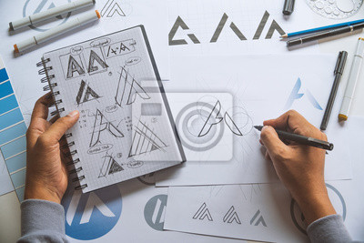 Bild Graphic designer development process drawing sketch design creative Ideas draft Logo product trademark label brand artwork. Graphic designer studio Concept.
