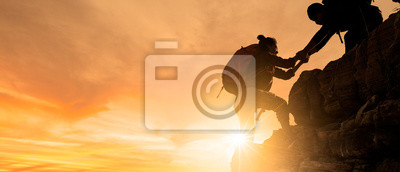 Bild Group of Asia hiking help each other silhouette in mountains with sunlight.