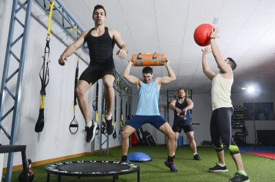 Bild Group of people in action doing crossfit exercises