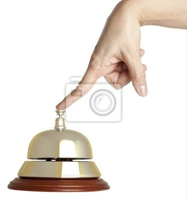 Hand einer Frau mit einem Hotel Glocke isoliert