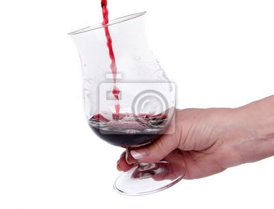 Bild Hand hält ein Glas, in dem Wein wird gegossen