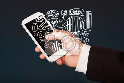 Bild Hand holding phone with hand drawn speech bubbles