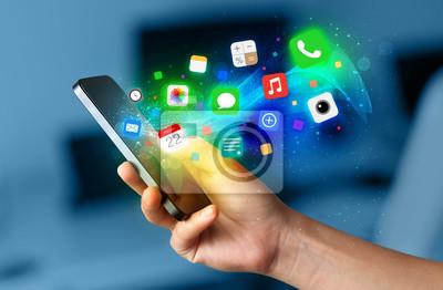 Hand holding smartphone mit bunten app icons