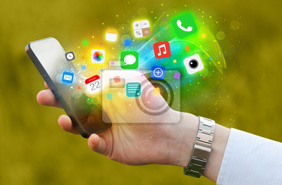 Bild Hand holding smartphone with colorful app icons