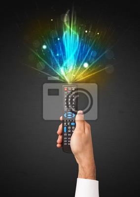 Bild Hand mit Fernbedienung und explosive Signal