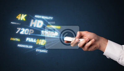 Bild Hand mit Fernbedienung und Multimedia-Eigenschaften
