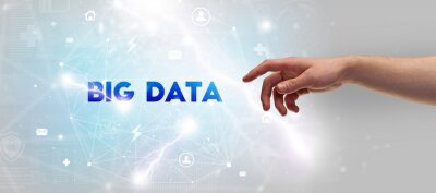 Hand pointing at BIG DATA inscription, modern technology concept