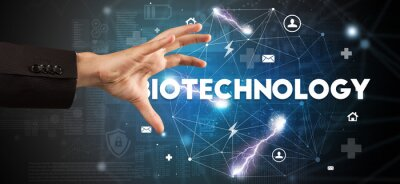 Hand pointing at BIOTECHNOLOGY inscription, modern technology concept