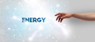 Hand pointing at ENERGY inscription, modern technology concept