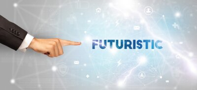 Hand pointing at FUTURISTIC inscription, modern technology concept