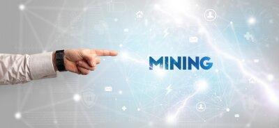 Hand pointing at MINING inscription, modern technology concept