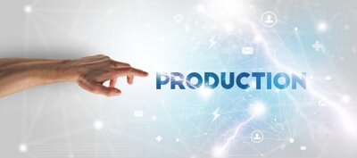 Hand pointing at PRODUCTION inscription, modern technology concept