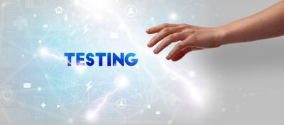 Hand pointing at TESTING inscription, modern technology concept