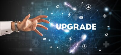Hand pointing at UPGRADE inscription, modern technology concept