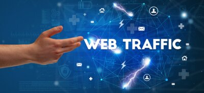 Hand pointing at WEB TRAFFIC inscription, modern technology concept