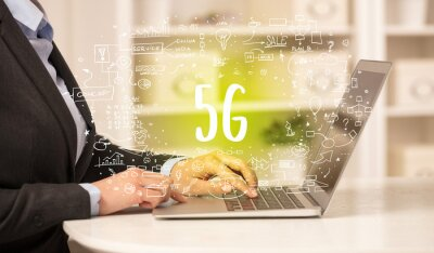 hand working on new modern computer with 5G abbreviation, modern technology concept
