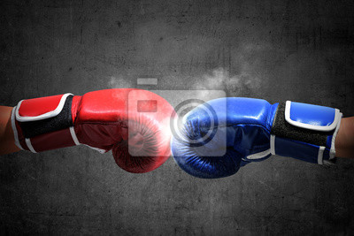 Bild Hands of two men with blue and red boxing gloves bumped their fists