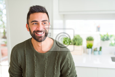Bild Handsome man smiling cheerful with a big smile on face showing teeth, positive and happy expression