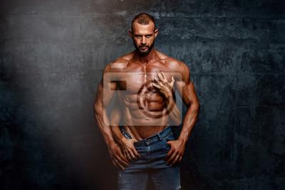 Bild Handsome Muscular Men Posing With Women Hands Around his Torso