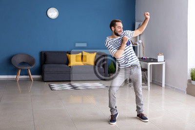 Bild Handsome young man dancing at home