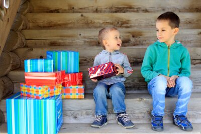 Bild happy brothers with lots of presents. cute kids opening the gifts