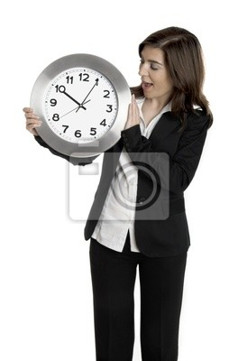 Happy business holding eine Uhr isoliert auf weiß