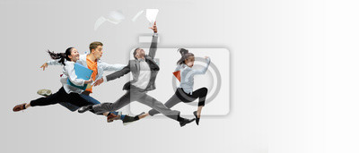 Bild Happy office workers jumping and dancing in casual clothes or suit with folders on white. Ballet dancers. Business, start-up, working open-space, motion and action concept. Creative collage. Copyspace
