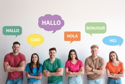 Bild Happy people posing near light wall and illustration of speech bubbles with word Hello written in different languages
