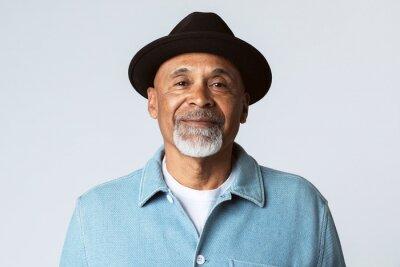 Bild Happy senior man wearing a black hat