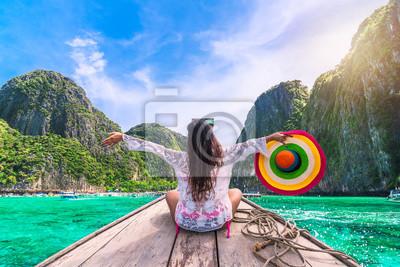 Bild Happy traveler woman in beach wear joy fun on boat, Maya bay Phi Phi island Krabi, Attraction place tourist travel Phuket Thailand summer holiday vacation trips, Tourism beautiful destinations Asia