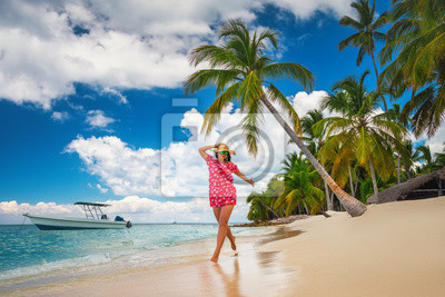 Happy woman having fun on tropical island beach, Punta Cana Dominican Republic