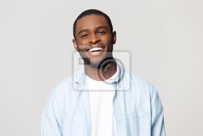 Bild Head shot portrait happy African American man with healthy smile