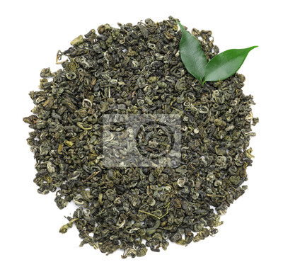 Bild Heap of dry green tea leaves on white background, top view
