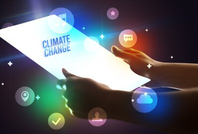 Holding futuristic tablet with CLIMATE CHANGE inscription, new technology concept