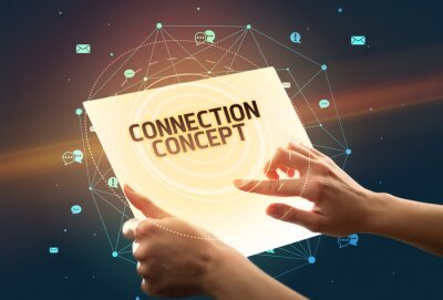 Holding futuristic tablet with CONNECTION CONCEPT inscription, social media concept