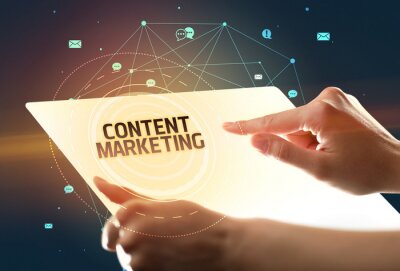 Holding futuristic tablet with CONTENT MARKETING inscription, social media concept