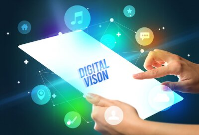 Holding futuristic tablet with DIGITAL VISON inscription, new technology concept