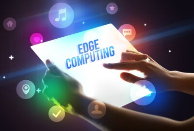 Holding futuristic tablet with EDGE COMPUTING inscription, new technology concept