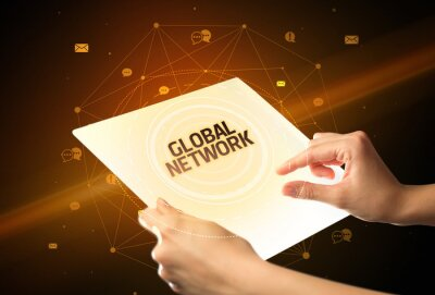 Holding futuristic tablet with GLOBAL NETWORK inscription, social media concept