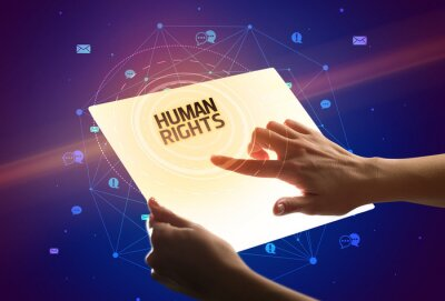 Holding futuristic tablet with HUMAN RIGHTS inscription, social media concept