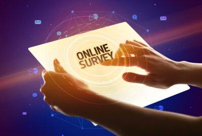 Holding futuristic tablet with ONLINE SURVEY inscription, social media concept