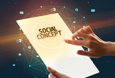 Holding futuristic tablet with SOCIAL CONCEPT inscription, social media concept