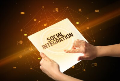 Holding futuristic tablet with SOCIAL INTEGRATION inscription, social media concept